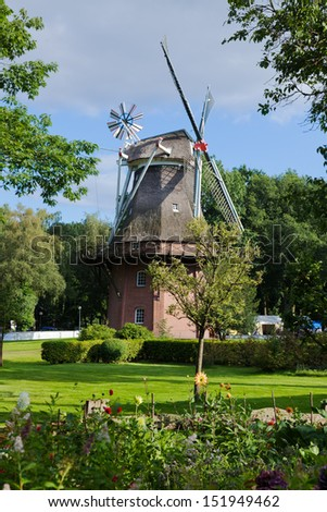 An old windmill in Bad Zwischenahn, northern Germany. - stock photo