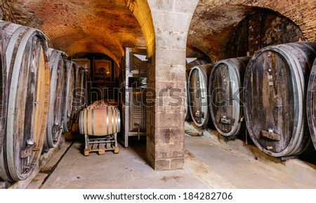 An Old Wine Cellar With Wooden Barrels - stock photo