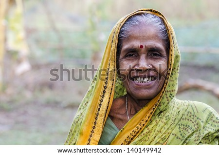 An old woman in an Indian village - stock photo