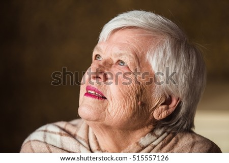 an old woman looking up with hope