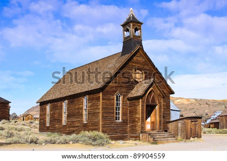 An old wooden church located in an old west ghost town. - stock photo