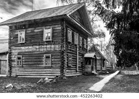An old wooden house captured in Russia in black and white