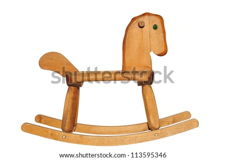 An old wooden rockinghorse, isolated on white - stock photo