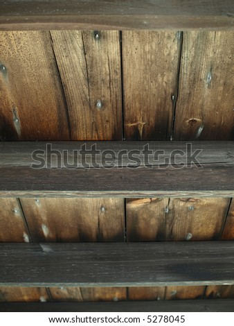 An old wooden slat ceiling with exposed beams - stock photo