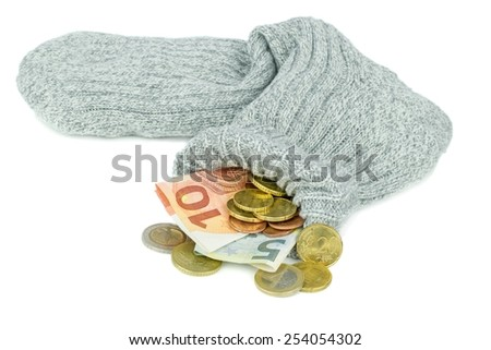 An old woolen sock full of Euro money on a white background - stock photo