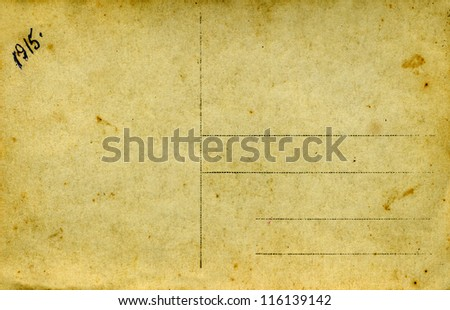 An old yellowed postcard, 1915 year,Russia. Isolated on white background.