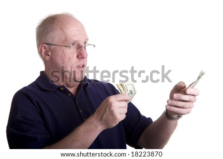 An older bald guy in a blue shirt counting out money