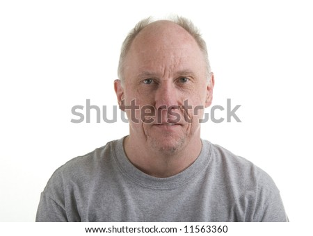 An older bald guy in a grey t-shirt on a white background