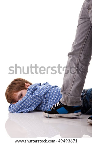 an older boy crushing the glasses to a younger boy - stock photo