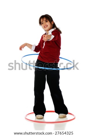 An older elementary girl spinning a hoola hoop.  Isolated on white.