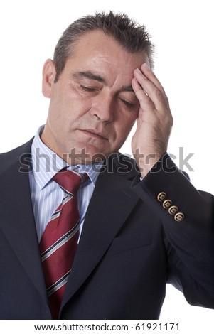 an older man suffering from a headache - stock photo