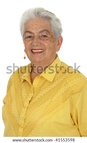 An older smiling woman in a yellow shirt over white background - stock photo