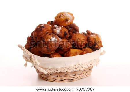 An Oliebol is typical Dutch and is only baked during te days between Christmas and New Year - stock photo