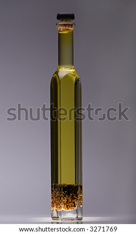 An Olive Oil Bottle Filled With Herbs - stock photo