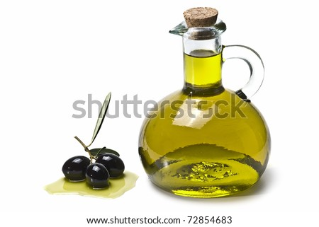 An olive oil pourer and some olives isolated on a white background. - stock photo