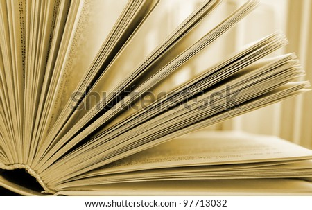 an open book lying on the table - stock photo