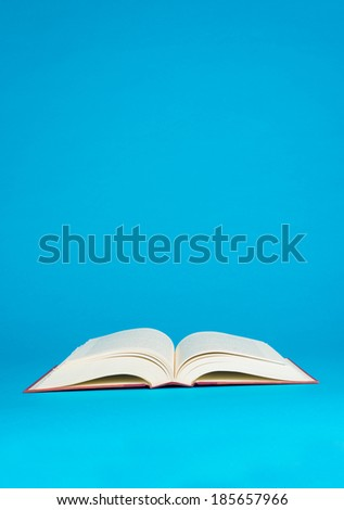 An open book on a bright blue background