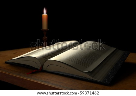 An open book on a dark background illuminated with a candle - stock photo