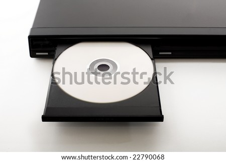 an open dvd-player with a dvd in it - stock photo