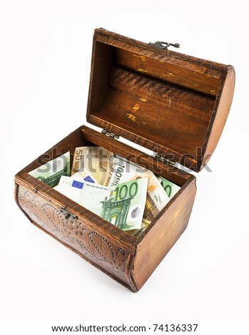 An open, wooden chest decorated with ornaments and euro bills. - stock photo