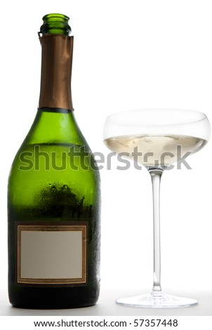 An opened green bottle of champagne (with a blank label) next to a saucer style champagne glass.  Studio isolated on a white background. - stock photo