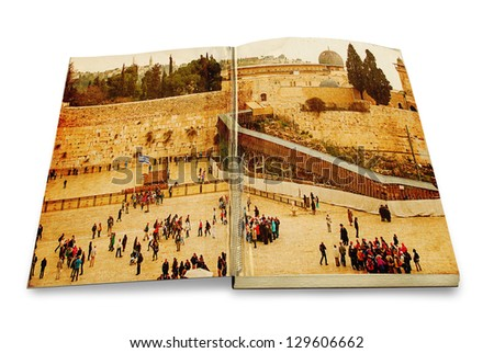 An opened old book with a picture Western Wall,Temple Mount, Jerusalem, Israel. Photo in old color image style on white background - stock photo