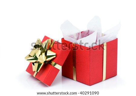 An opened red Christmas present box with a golden bow - stock photo