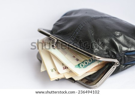 An opened wallet with russian ruble banknotes inside