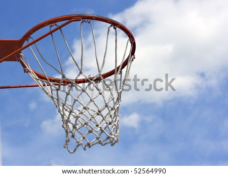 An orange basketball hoop against a blue sky