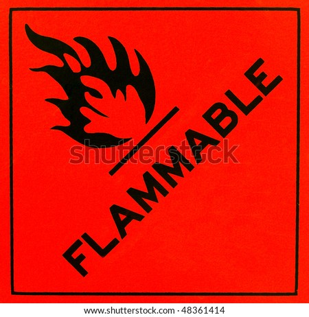 An orange flammable warning sign with black writing - stock photo