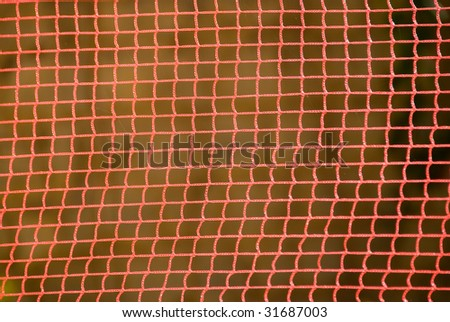An orange nylon net closeup