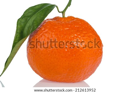 an orange sits on a white background. symbolic photo for healthy vitamins with fresh fruit - stock photo