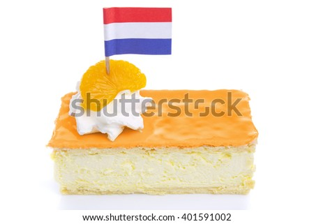 An orange tompouce, traditional Dutch pastry, on a white background. The orange icing on the tompouce is typical for King's Day ('Kongingsdag') on April 27th. - stock photo