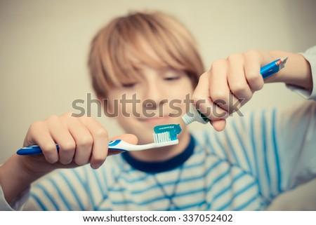 an ordinary day - brush your teeth - stock photo