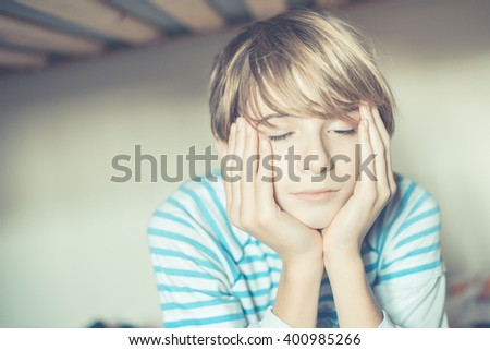 an ordinary day - schoolboy awakening - stock photo
