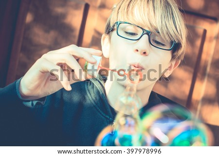 an ordinary day - soap bubbles after school - vintage style photo - stock photo