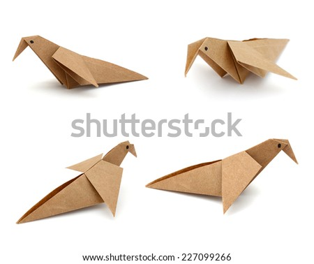 An origami bird on white background  - stock photo