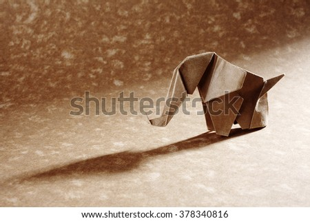 An origami elephant isolated on craft paper background. - stock photo