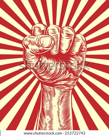 An original illustration of a revolutionary fist held in the air in a vintage wood cut propaganda style - stock photo