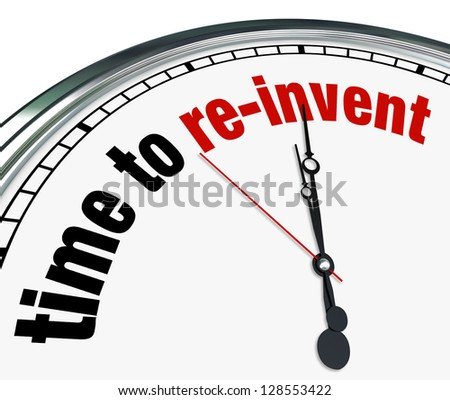 An ornate clock with the words Time to Re-Invent on its face - stock photo