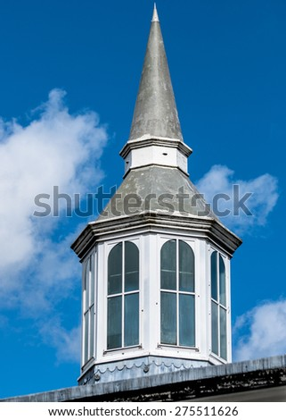 An ornate roof turret on a Victorian building. - stock photo