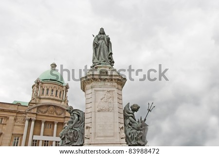 An Ornate Statue of Queen Victoria in an English City Square - stock photo