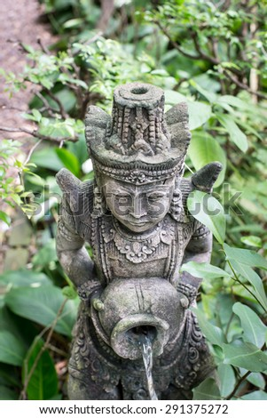An ornately carved stone statue - stock photo