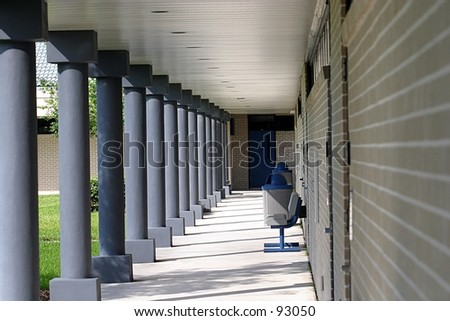 An outdoor cooridoor at a community college. - stock photo
