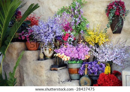 An outdoor staircase filled with an assortment of beautiful flowers.