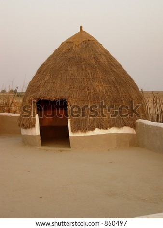 an oval shaped house in a village in india - stock photo