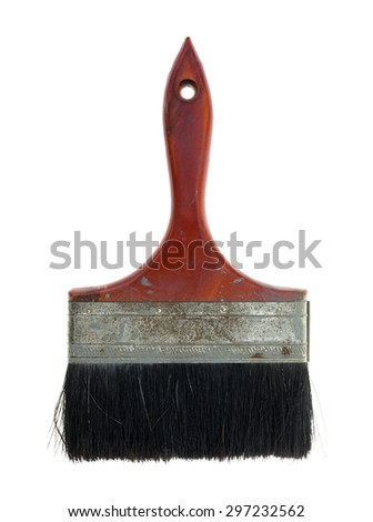 An overhead view of an old used paintbrush with wooden handle and hole to hang it up. - stock photo
