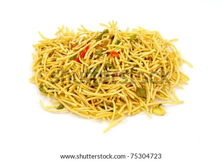 An overhead view of noodles, vegetables, seasoning mix.