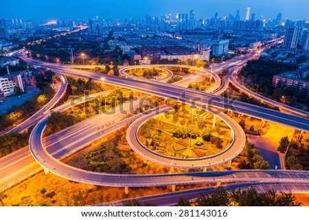 an overpass closeup on the junction at night in tianjin, China - stock photo