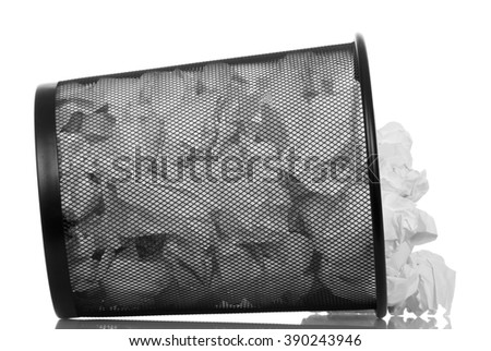 An overturned basket full of waste paper isolated on white background. - stock photo